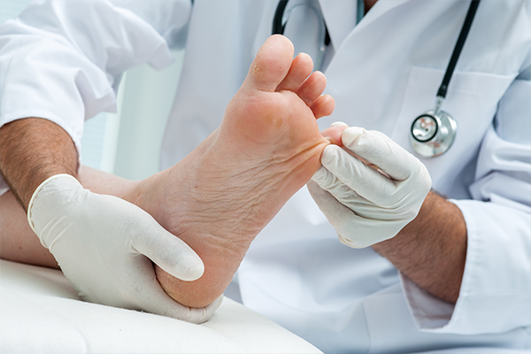 An image of a chiropodist inspecting someones foot